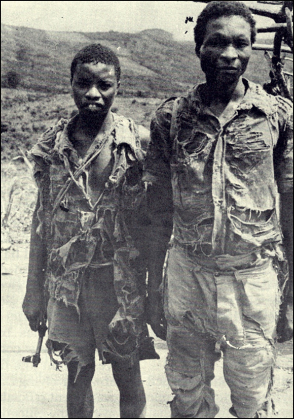 Militiamen in ragged clothes, Zambézia, 1980s