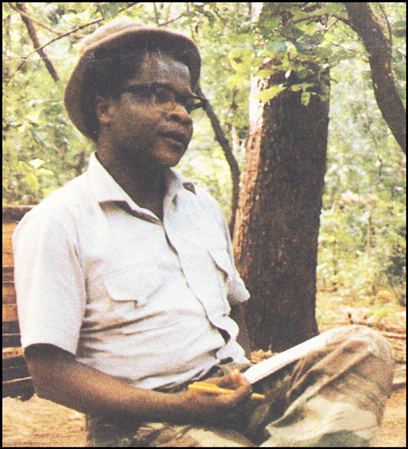Afonso Dhlakama in civilian clothes, on a bench