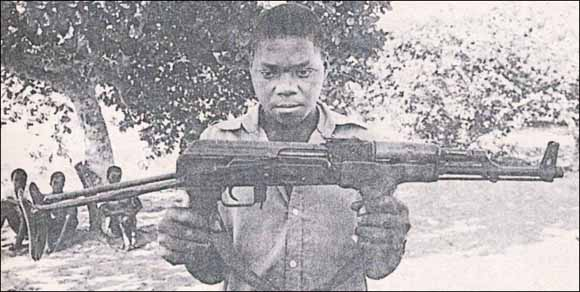 Renamo prisoner with gun